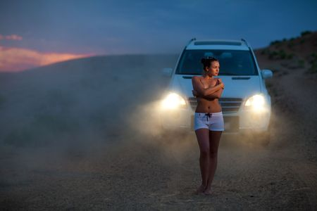 early summer: girl and car in the evening