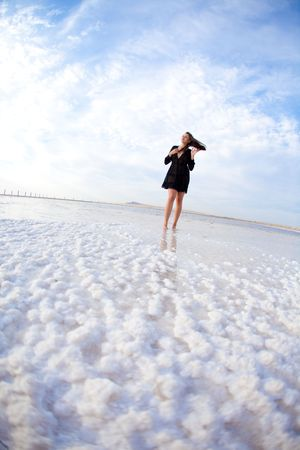 girl in a salt lake in a sunrise photo