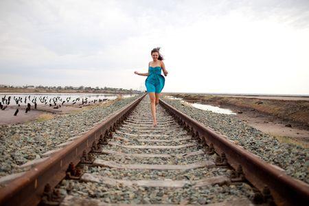running girl on the railway photo
