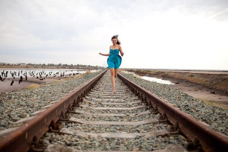 running girl on the railway photo