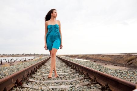 walking girl on the railway photo
