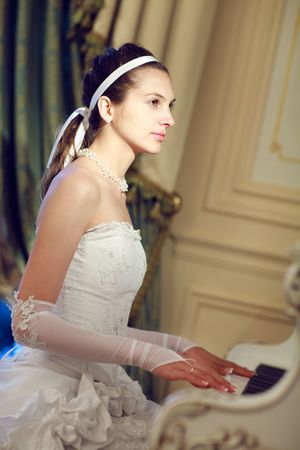 bride playing the grand piano Stock Photo - 5485690