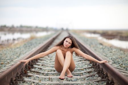 siting girl on the railway