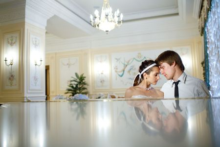 happy bride and groom at the piano