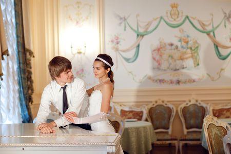 happy bride and groom near the piano photo