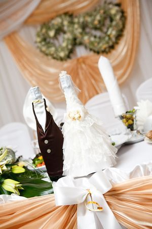bolltes of champagne as bride and groom photo