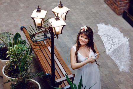 pretty young bride with umbrella photo