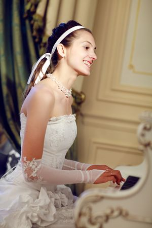 bride playing the grand piano Stock Photo - 6305831
