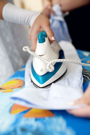 a girl ironing a shirt of a man Stock Photo - 6284831