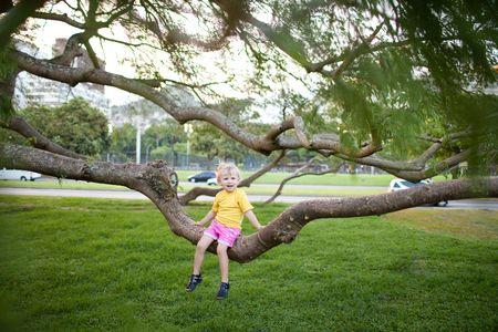 frightentd child on the tree photo