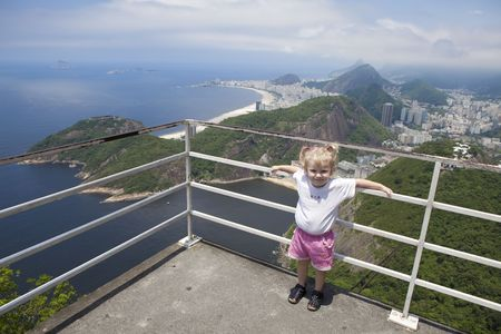 small girl at a high viewing platform photo