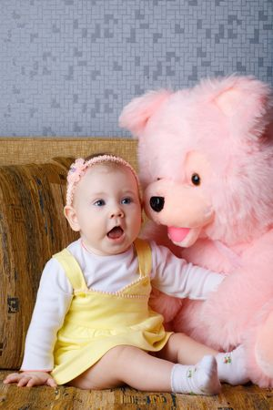 pink teddy bear: small girl with big toy bear