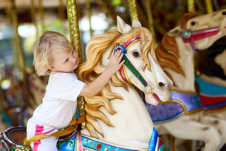 amusement: child in park of attractions