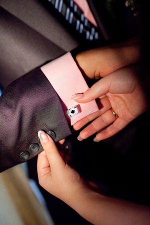 cufflink: putting on a cufflink