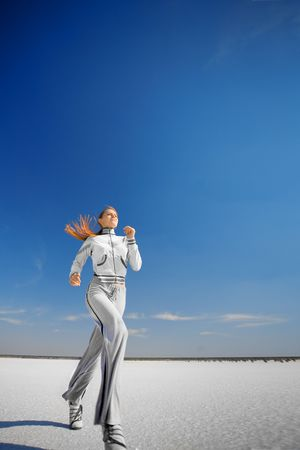 running girl on the white salt land Stock Photo - 6612586
