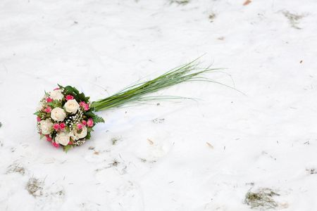 bridal bouquet: wedding flowers on the snow Stock Photo