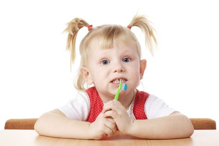 child with toothbrush in hands photo
