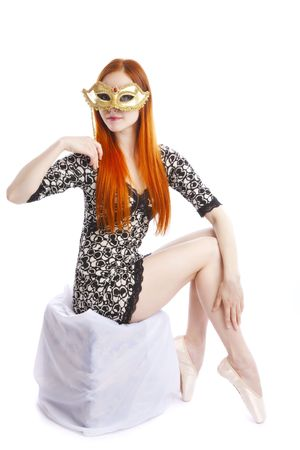 ballet dancer looks through the venetian mask   photo