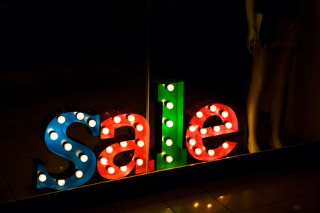 advertisement Sale in the shop at night Stock Photo - 6845266