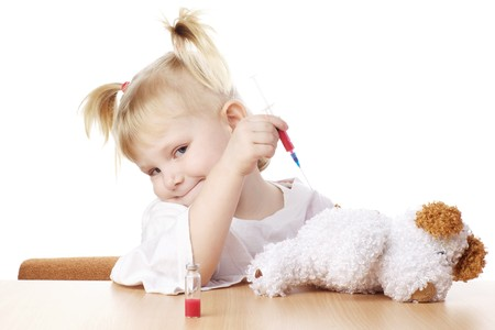 ilness: child playing as a doctor with syringe Stock Photo
