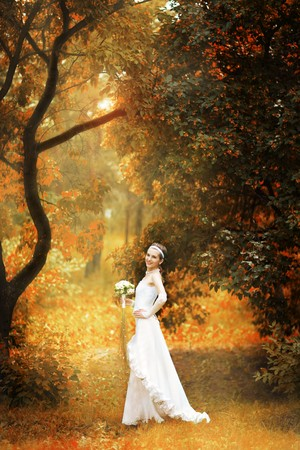 happy bride on autumn forest Stock Photo
