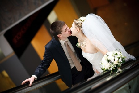 kiss of bride and groom in metro photo