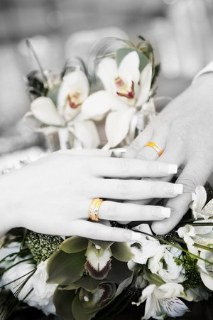 hand of groom and hand of bride with wedding rings on the flower bouquet in black and white Stock Photo - 7055200
