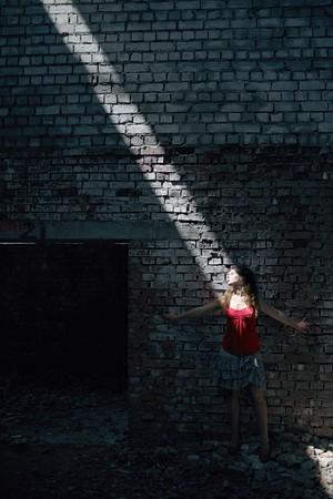 girl in the diagonal of sun light photo