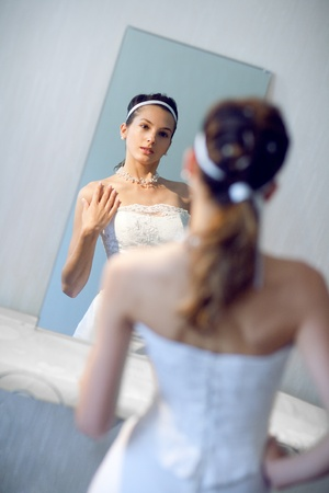 face of the bride in the mirror photo