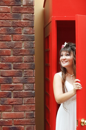 bride in the red telephone cabin photo