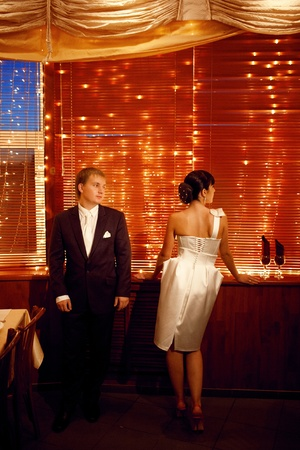 couple by the window with lights photo