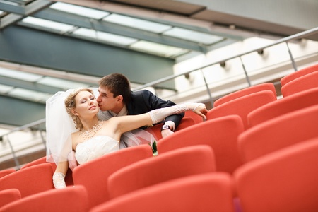 bride and groom in the cinema photo