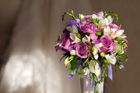 bouquet of flowers and wedding dress photo