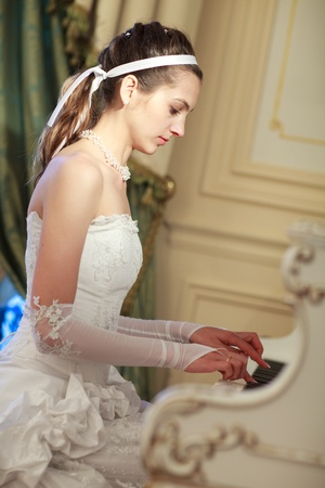bride playing the grand piano Stock Photo - 9022943