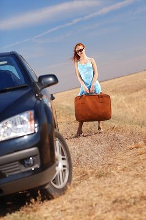 young girl near the car photo