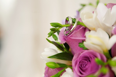 bouquet of flowers and wedding dress as background Stock Photo