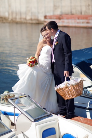 bride and groom kissing on the pier photo