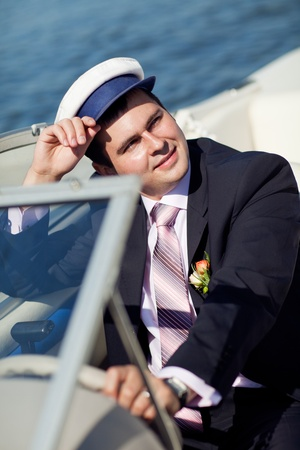 portrait of a Captain managing the yacht photo