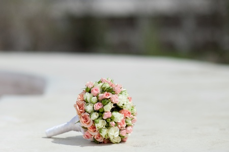 small details: wedding bouquet on the white stone background Stock Photo