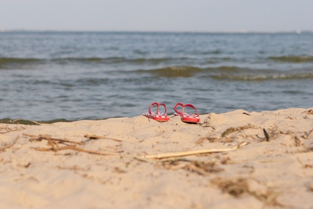sandals on the beach of sand photo