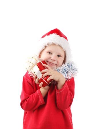 child in Santas cap with present photo