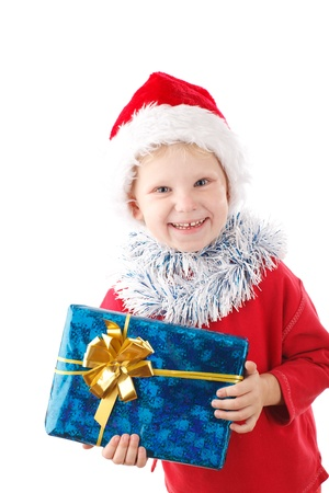 child in Santas cap with present photo