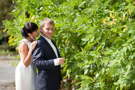 murmur: bride and groom near the bush