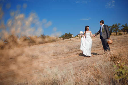 bride and groom walking on the road photo