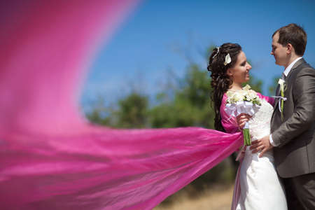 wedding portrait: bride and groom with the pink shawl Stock Photo