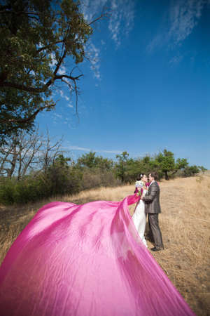 bride and groom with the pink shawl photo
