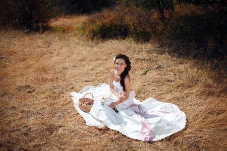 bride on the yellow dry grass photo