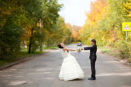 bride and groom on the road photo