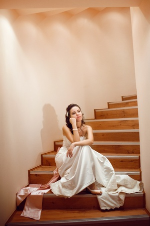 pretty bride on the staicase photo