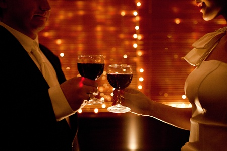 red wine glas in hands of lovers photo